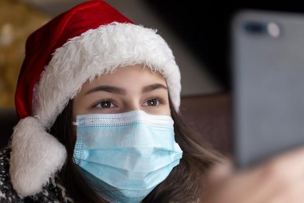 student wearing face covering at christmas